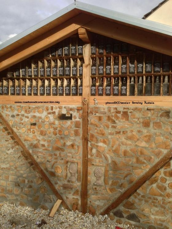 Miroslav Bentley Kubala Cordwood carport near Prague gable ends with Jack Daniels bottles - Copy